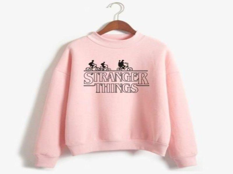 Ropa Stranger Things niña sudadera rosada